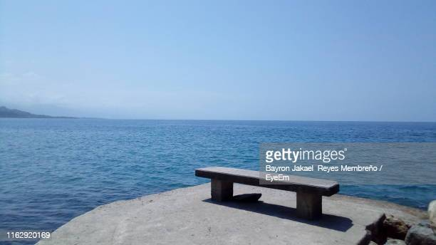 scenic view of sea against clear sky - 防波堤 ストックフォトと画像