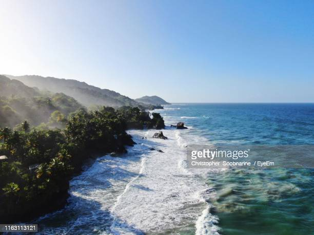 scenic view of sea against clear sky - trinidad and tobago stock pictures, royalty-free photos & images