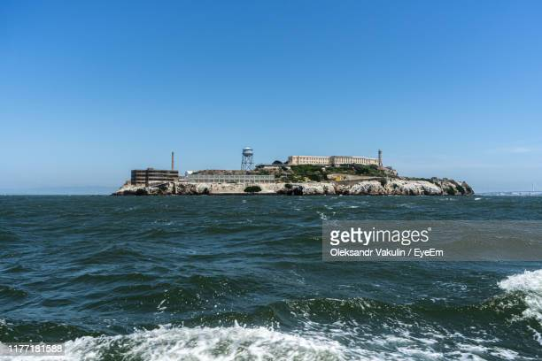 scenic view of sea against clear sky - oleksandr vakulin stock pictures, royalty-free photos & images