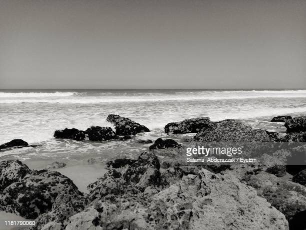 scenic view of sea against clear sky - punalu'u_beach stock pictures, royalty-free photos & images