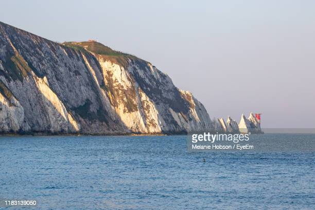 scenic view of sea against clear sky - alum bay stock pictures, royalty-free photos & images