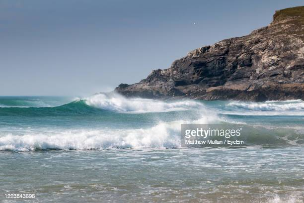 scenic view of sea against clear sky - wave stock pictures, royalty-free photos & images