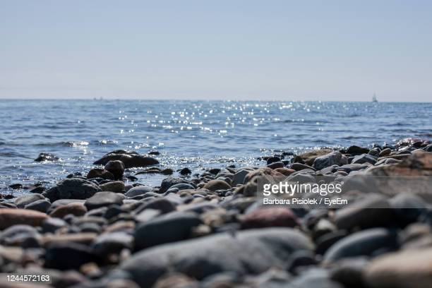 scenic view of sea against clear sky - pebble stock pictures, royalty-free photos & images