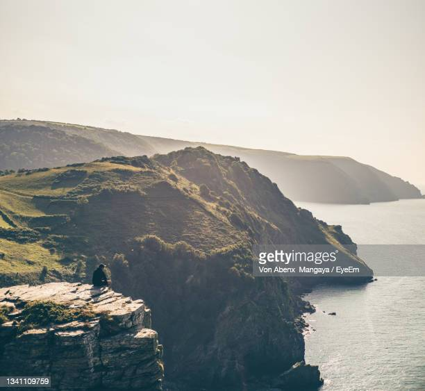 scenic view of sea against clear sky - lynton stock pictures, royalty-free photos & images
