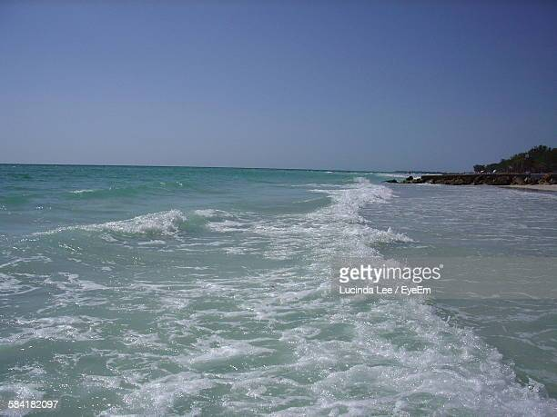 scenic view of sea against clear sky - lucinda lee stock photos and pictures