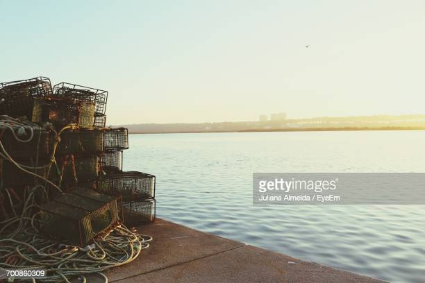 scenic view of sea against clear sky - crab pot stock photos and pictures