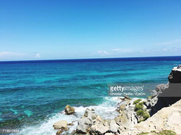 scenic view of sea against clear sky - isla mujeres stock photos and pictures