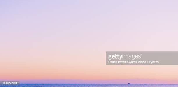 scenic view of sea against clear sky - dusk stock pictures, royalty-free photos & images