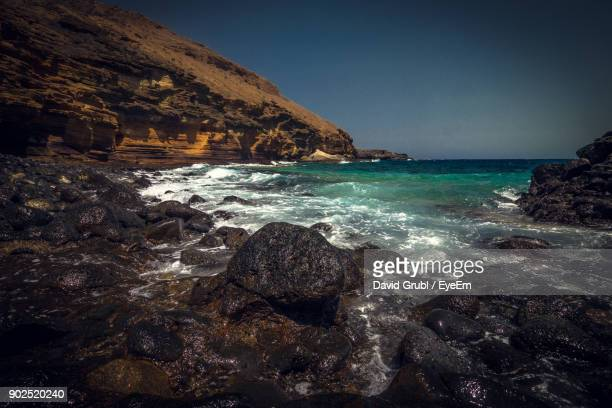 scenic view of sea against clear sky - david cliff stock pictures, royalty-free photos & images