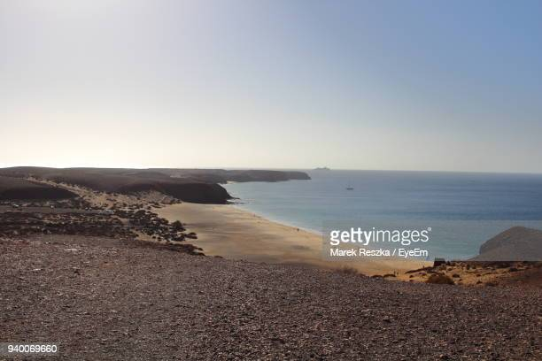 scenic view of sea against clear sky - arrecife stock photos and pictures