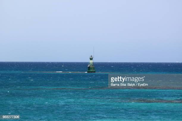 scenic view of sea against clear sky - buoy stock photos and pictures