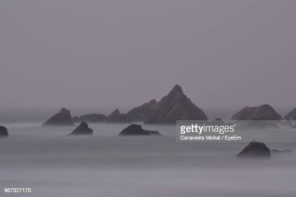 scenic view of sea against clear sky - praia stock pictures, royalty-free photos & images