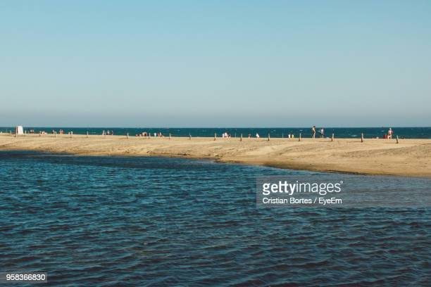 scenic view of sea against clear sky - bortes stock-fotos und bilder