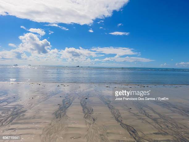 Scenic View Of Sea Against Cloudy Blue Sky On Sunny Day