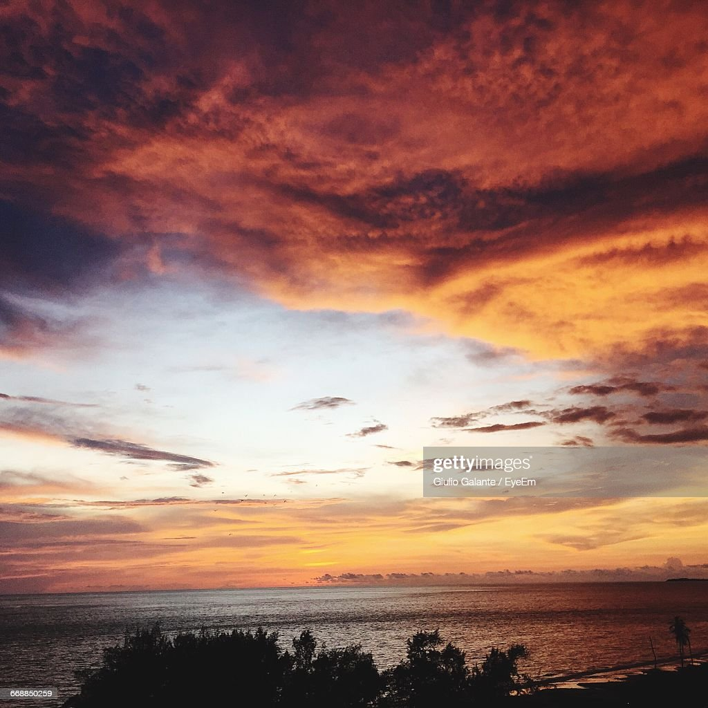 Scenic View Of Sea Against Cloudy Sky At Sunset : Stock Photo