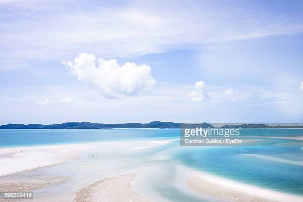 Scenic View Of Sea Against Cloudy Sky At Whitsunday Islands