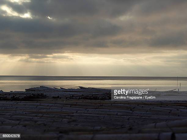scenic view of sea against cloudy sky during sunrise - carolina fragapane stock pictures, royalty-free photos & images