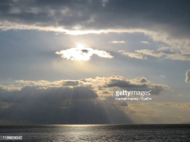 scenic view of sea against cloudy sky during sunset - hannah brooks stock pictures, royalty-free photos & images