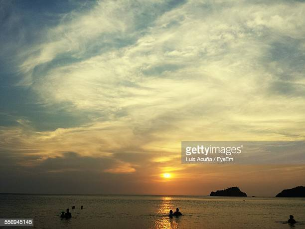 scenic view of sea against cloudy sky during sunset - barranquilla stock photos and pictures