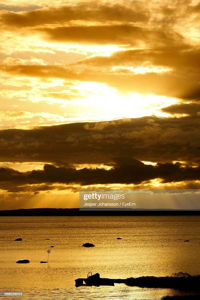 Scenic View Of Sea Against Cloudy Sky During Sunset : Stock Photo