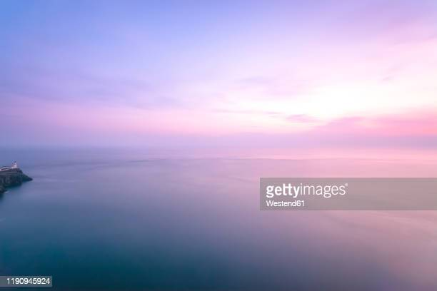 scenic view of sea against cloudy sky during sunset, waterstein, isle of skye, highlands, scotland, uk - dusk stock pictures, royalty-free photos & images