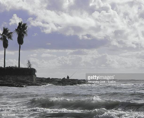 Scenic View Of Sea Against Cloudy Sky On Sunny Day
