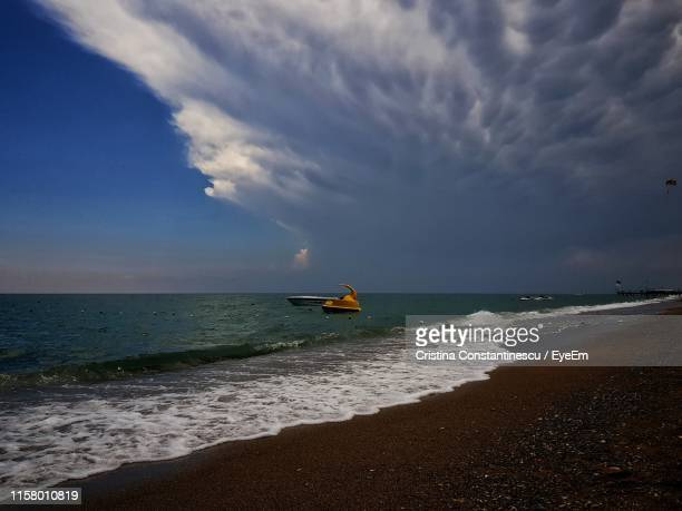 scenic view of sea against cloudy sky - belek stock pictures, royalty-free photos & images