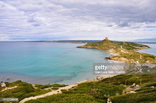 scenic view of sea against cloudy sky - lookout tower stock pictures, royalty-free photos & images