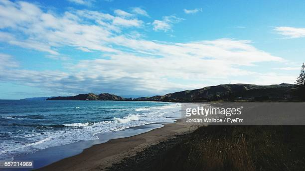 scenic view of sea against cloudy sky - gisborne stock photos and pictures