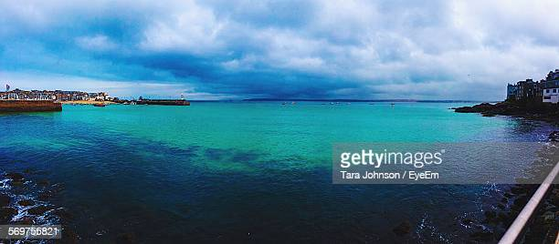 scenic view of sea against cloudy sky - st ives stock pictures, royalty-free photos & images
