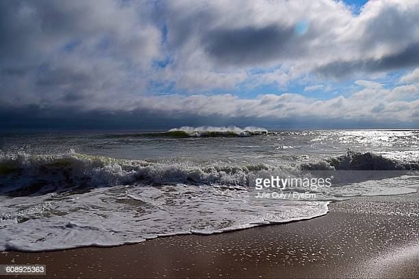 scenic view of sea against cloudy sky - julie culy stock pictures, royalty-free photos & images
