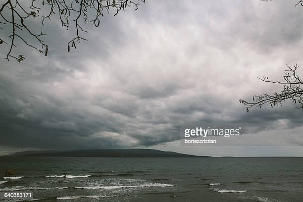 scenic view of sea against cloudy sky - bortes cristian stock-fotos und bilder