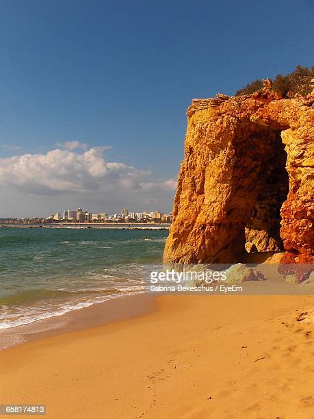 scenic view of sea against cloudy sky - alvor stock pictures, royalty-free photos & images