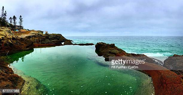 scenic view of sea against cloudy sky - laguna niguel stock pictures, royalty-free photos & images