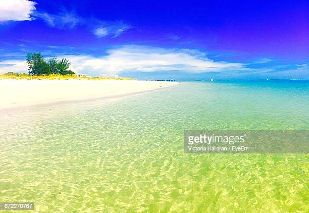 scenic view of sea against cloudy sky - siesta key stock pictures, royalty-free photos & images