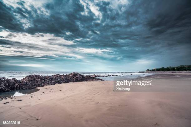 scenic view of sea against cloudy sky - dramatic sky stock pictures, royalty-free photos & images