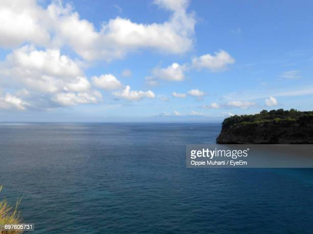 scenic view of sea against cloudy sky - oppie muharti stock pictures, royalty-free photos & images