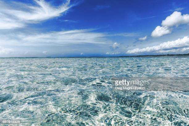 scenic view of sea against cloudy sky - mombasa stock photos and pictures