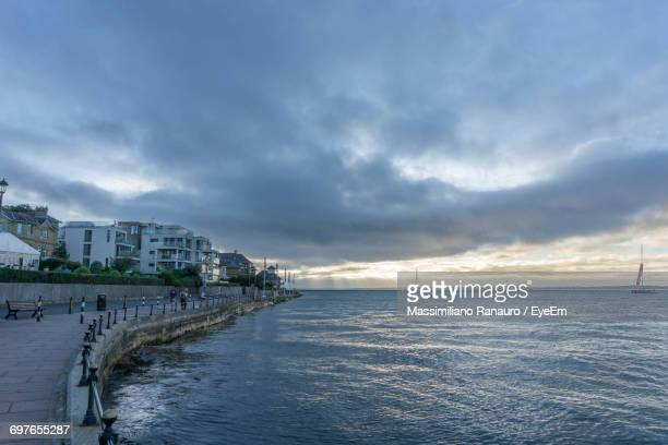 scenic view of sea against cloudy sky - massimiliano ranauro stock pictures, royalty-free photos & images