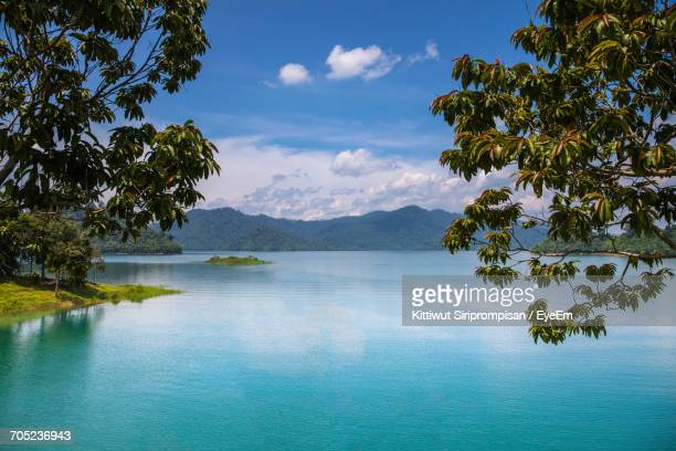 scenic view of sea against cloudy sky - surat thani province stock pictures, royalty-free photos & images