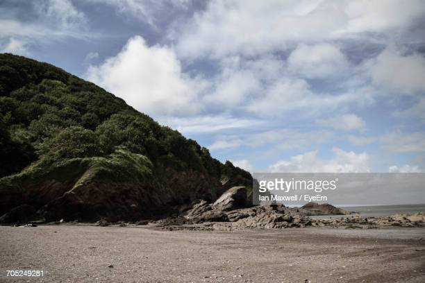 scenic view of sea against cloudy sky - ilfracombe stock pictures, royalty-free photos & images