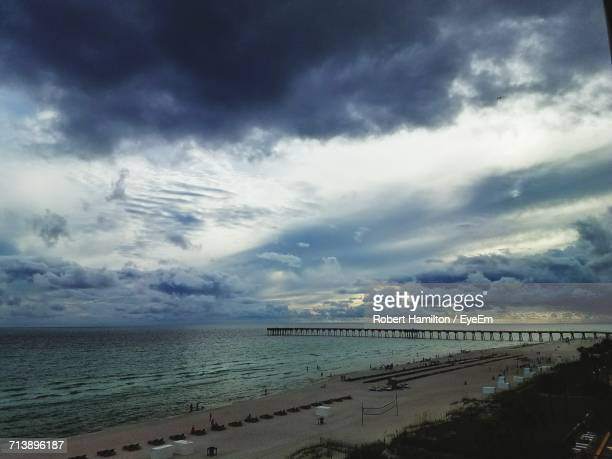 scenic view of sea against cloudy sky - panama city beach stock pictures, royalty-free photos & images