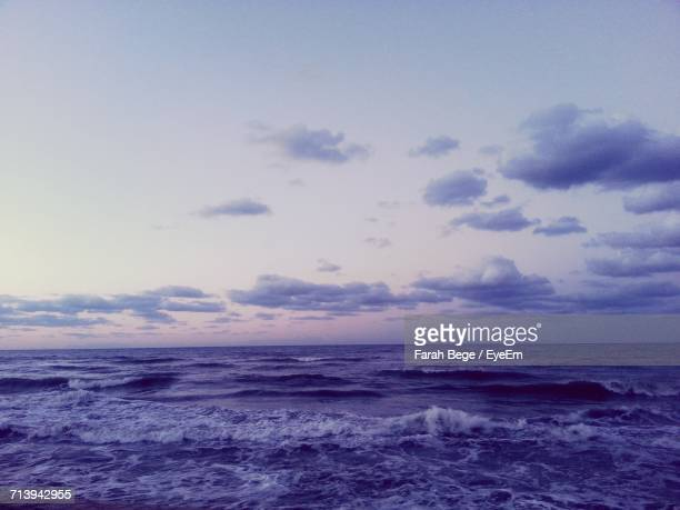 scenic view of sea against cloudy sky - bege stock photos and pictures