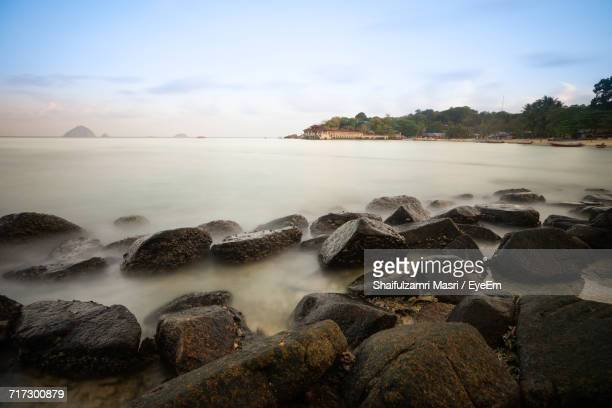 scenic view of sea against cloudy sky - shaifulzamri stock pictures, royalty-free photos & images
