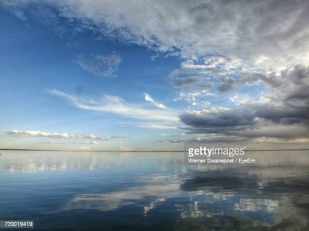 Scenic View Of Sea Against Cloudy Sky