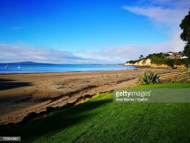 scenic view of sea against cloudy sky - brett barnes stock photos and pictures