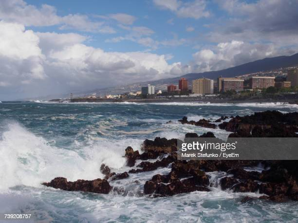 scenic view of sea against cloudy sky - marek stefunko stockfoto's en -beelden