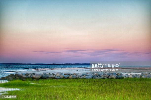 scenic view of sea against cloudy sky - hilton head stock pictures, royalty-free photos & images