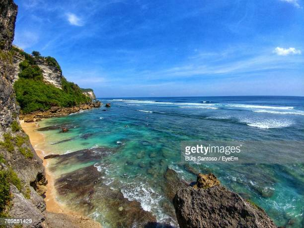 scenic view of sea against cloudy sky - east java province stock photos and pictures