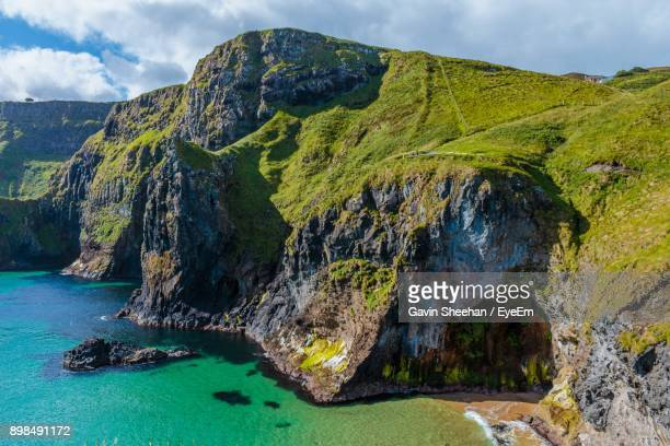 scenic view of sea against cloudy sky - county antrim stock pictures, royalty-free photos & images